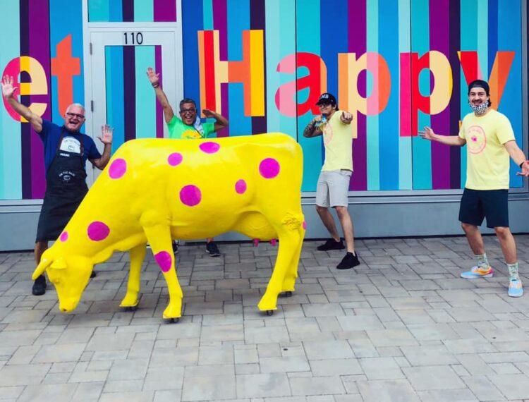 cow statue outside shop