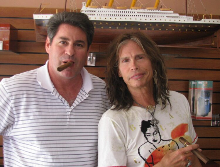 Steven Tyler in shop with owner