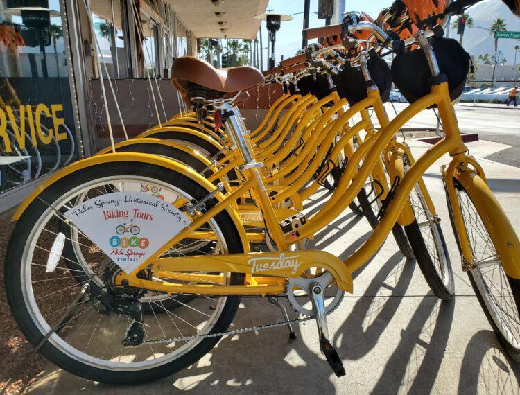 row of yellow bikes