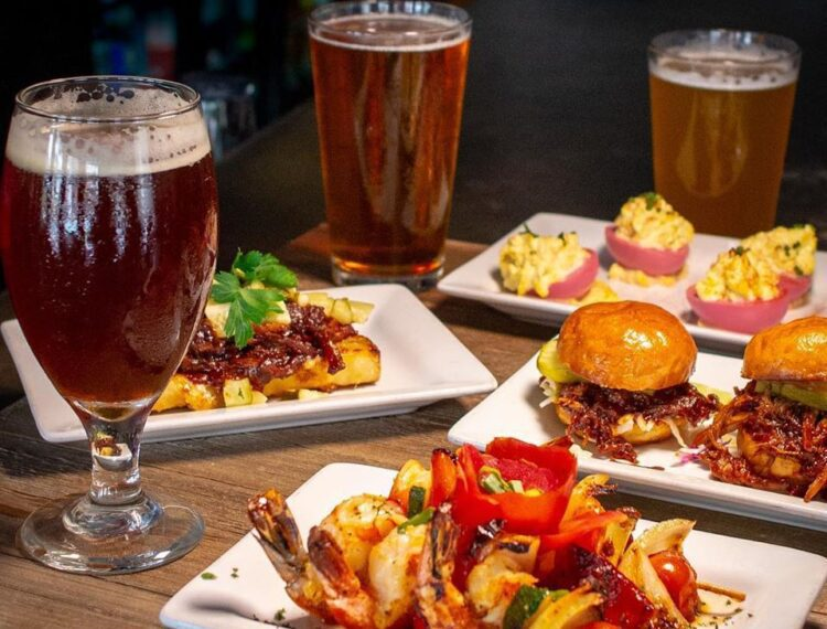 dishes of food with glasses of beer