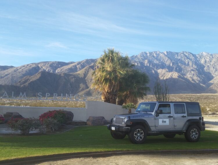 jeep in front of palm springs sign