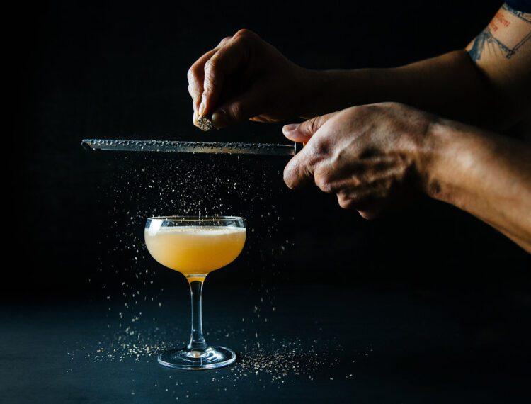 person preparing cocktail