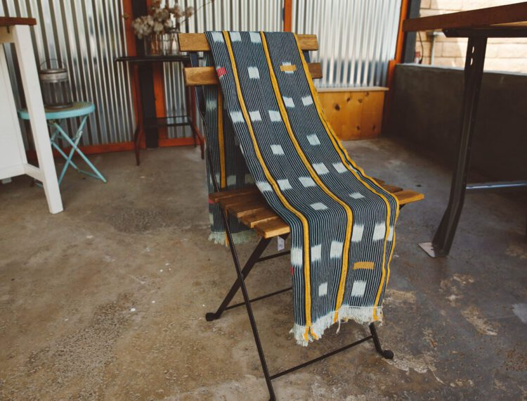 blanket laid over chair
