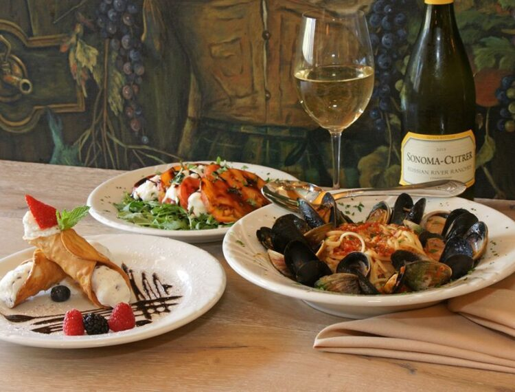 dishes of food with wine