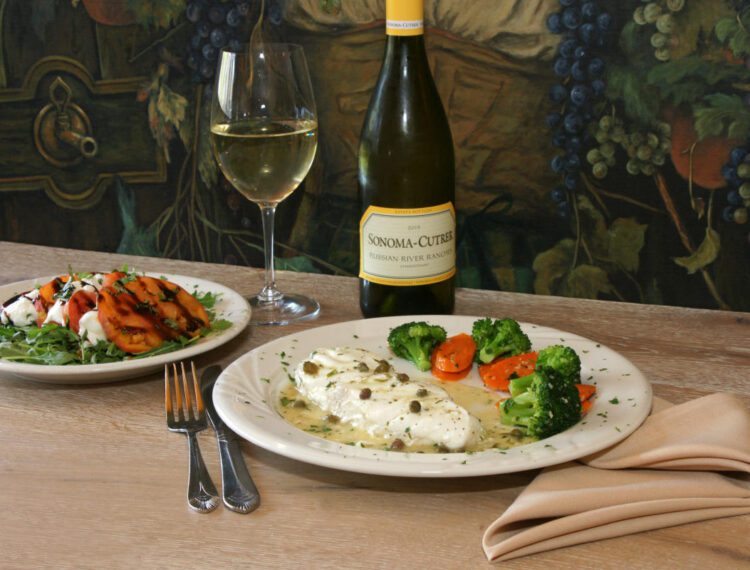 two dinner dishes with wine