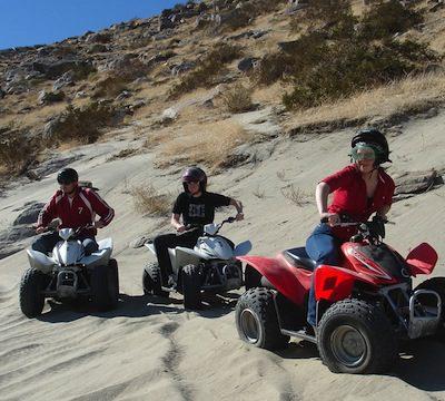 people riding ATVs