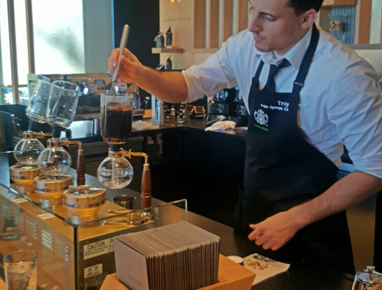 barista making a coffee
