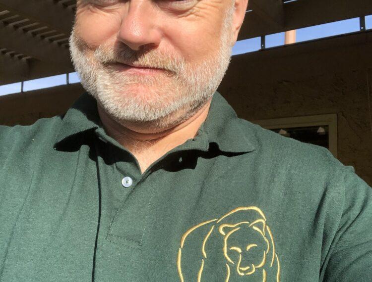 man in bear wear polo