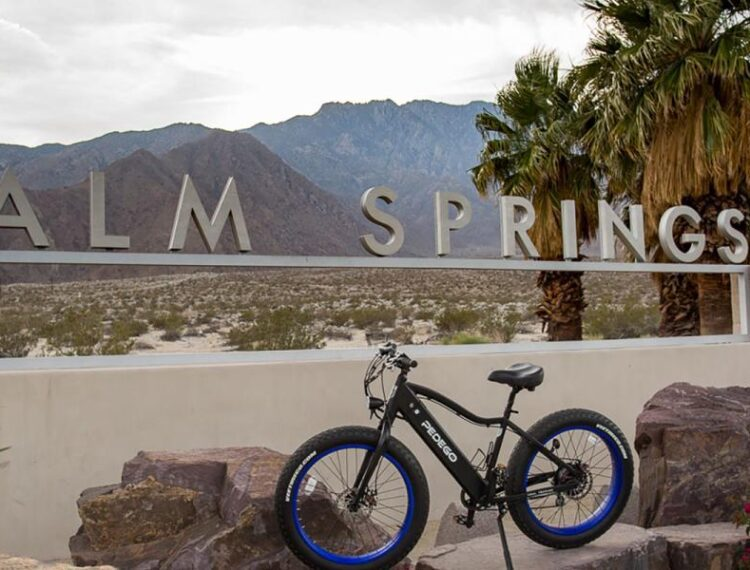 bike in front of Palm Springs sign