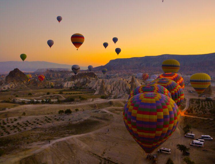 several hot balloons in flight
