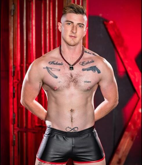 man in leather shorts