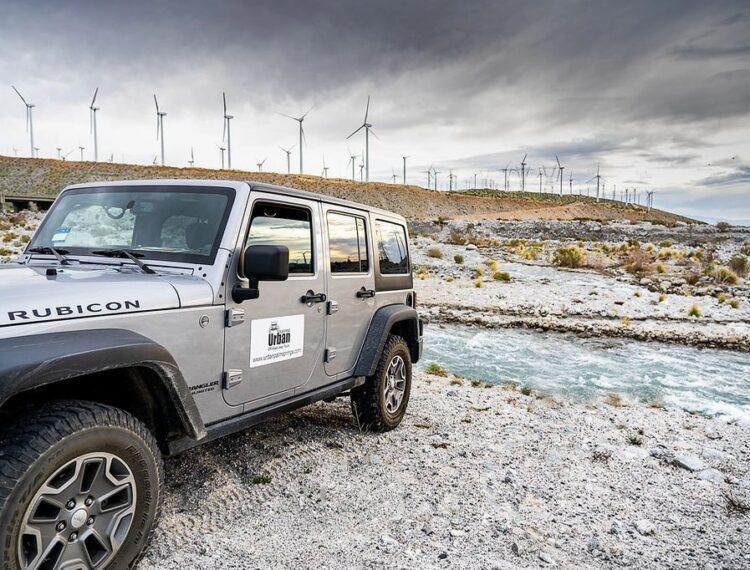 jeep parked near wind turbines