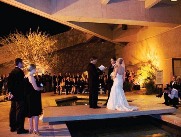 bride and groom on outdoor atrium bridge