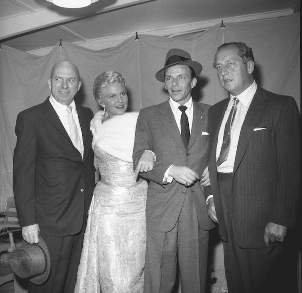 The ninth annual Police Show on March 29, 1958, From left, Jimmy Van Heusen, Peggy Lee, Sinatra, and Ray Ryan.