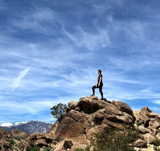 Woman at the top of rock